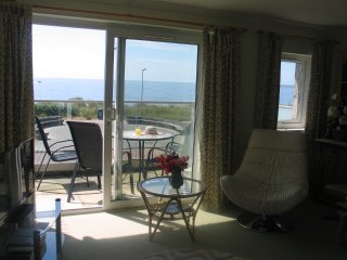 Sea-front house with panoramic views of Cardigan Bay and the mountains.Near town