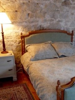 Bed and stone wall details