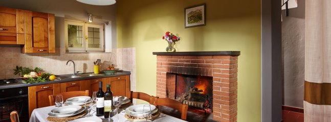House One kitchen with real fireplace