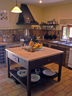 The large kitchen island is always the centre of shared kitchen activity.