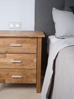 Bedroom No.1 Details: Bed, Bed sheets, Bed side table.