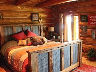 Gorgeous master suite facing river.  Lots of comfy blankets and pillows. We leave the windows open!