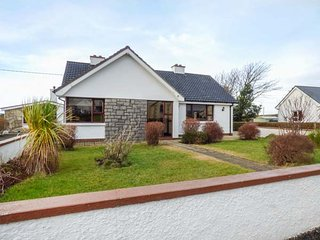ANNAGRY COTTAGE, woodburning stove, front and rear lawned garden, sea views, Annagry