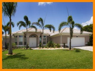 Luxury Cape Coral Vacation Home with South Facing Pool and Hot Tub, plus a boat dock on the canal.