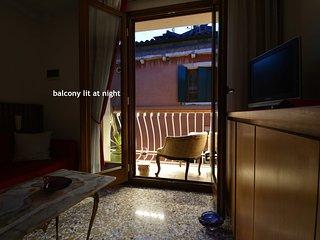 BALCONY LIT AT NIGHT: enjoy