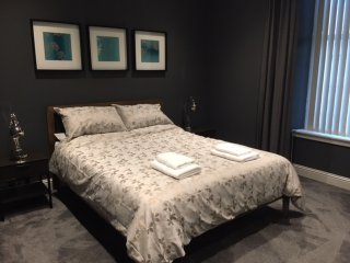 Master bedroom, with king size bed and fitted wardrobes.
