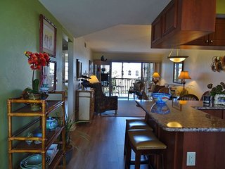 TROPICAL decor awaits in this lovely condo located in Popular Resort