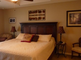 master bedroom with 3' memory foam topper. Private door to balcony
