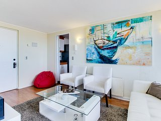 Ocean view getaway with a private balcony and a shared pool & fitness center!