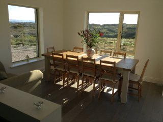 The conservatory is open plan with the kitchen - the main table seats 10 & the island seats 4