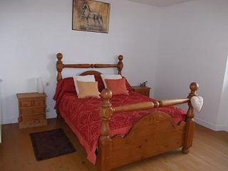 One of our en-suite bedrooms, with room for an extra bed and views over the Pyrenees