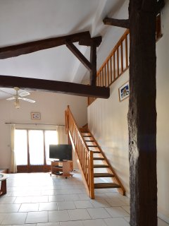 The beautiful staircase leading to the mezzanine beds and master bedroom.
