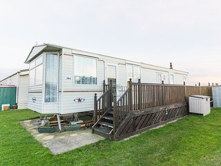 Ref 20304 Broadland Sands 6 berth caravan Holiday Park  seaview with decking.