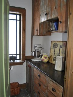 The pantry with antique cabinets.