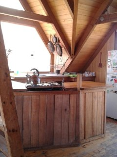 Fully equipped kitchen, gas stove with oven, two door fridge and bar.