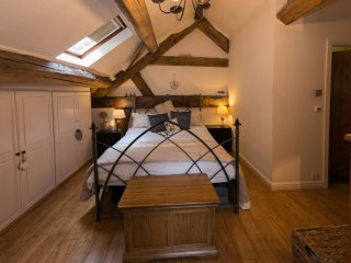 Spacious  bedroom in converted barn - oak beamed vaulted ceiling