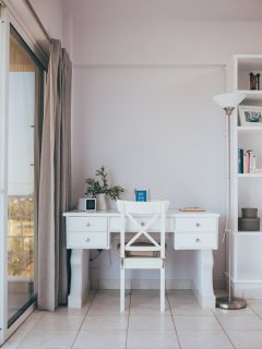 If pleasure comes with work, there is a spacious desk for you in the room