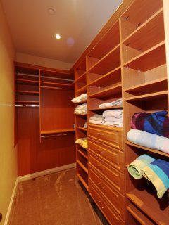 2nd Bedroom walk in closet with extra linens and games.