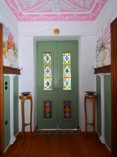 The hallway with the Four Seasons murals that give the apartment its name!