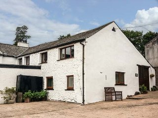 PEMBROKE COTTAGE, semi-detached, pet-friendly, shared garden, nr Keswick, Ref