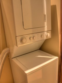 The villa does have a stacked washer and dryer for your convenience.