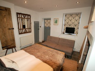Bedroom 3  (The Grey Room) on the Lower Ground Floor with direct access to the private garden.