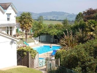 Jurassic coast holiday home with shared pool