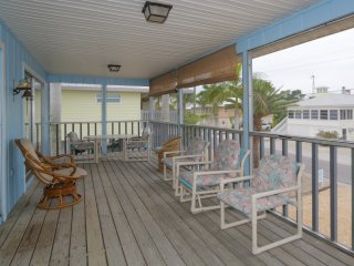 The porch is a perfect spot for sipping coffee or cocktails!