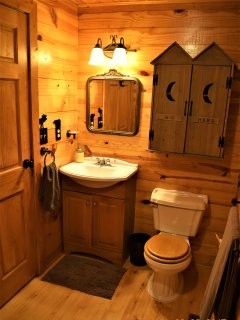 Downstairs bathroom featuring vanity and cabinet storage ~Wolf Ridge Retreat