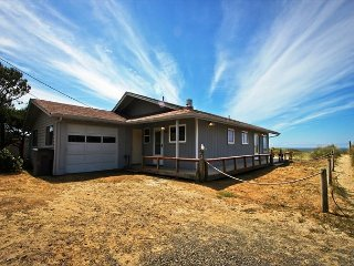 SANDY SHORES~Single story oceanfront home that is walking distance to town