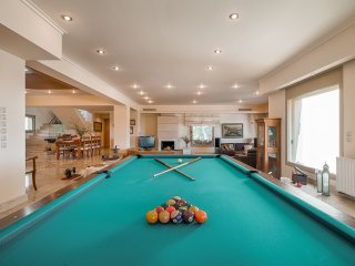Indoors there is a play room with a  billiard table