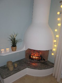 Electric heater disguised as a fireplace. Gives a cosy feeling.