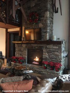Cozy up to the natural stone fireplace at Copperleaf at Eagles Nest.