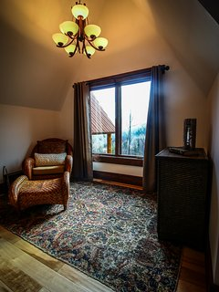 View of the sitting area in the first upstairs bedroom at Copperleaf at Eagle's Nest.