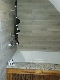 Custom tile shower and tub.
