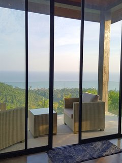 glass railings on the balcony enhance with their elegant design a pleasant atmosphere….