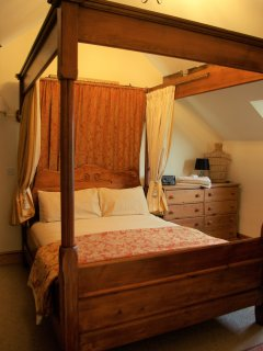 Luxurious Four Poster bed with Vi Spring mattress, reported by guests as the most comfortable bed!