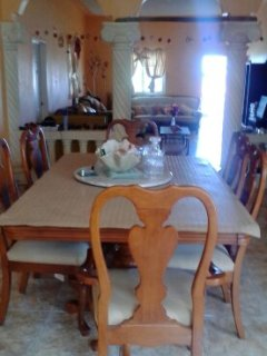 Through lounge with large Mahogany dinning table