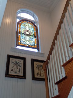 Antique stained glass window lights reclaimed heart pine stairway