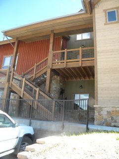 Exterior view of building - Townhome features private one car heated garage.