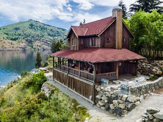 Escape with this wonderful waterfront cabin with dock & hot tub