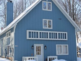 Located at Base of Powderhorn Mtn in the Western Upper Peninsula, A Trailside Home with Cozy Decor & Large Living Room