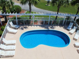 Large home with private pool. Across the street from the beach!!