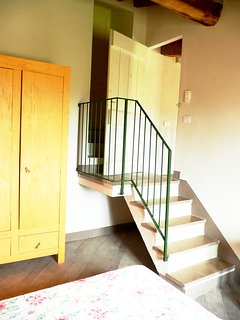 Staircase leads to the en-suite bathroom