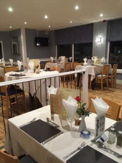 Refurbished restaurant set for dinner