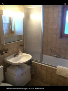 Bathroom with window and tub