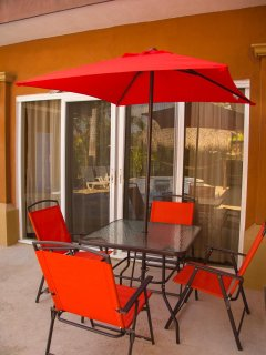 Patio table with 4 chairs, umbrella and charcoal BBQ