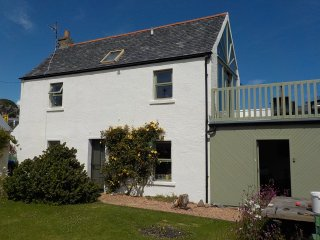 Skerries Cottage; traditional cottage with enclosed garden next to sea.