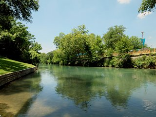 Remarkable 2 Bedroom waterfront condo overlooking the gorgeous Comal River!