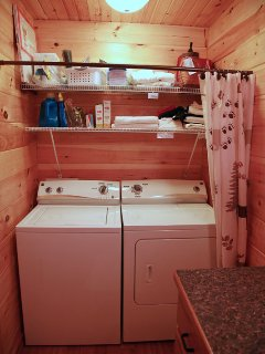 Full-sized washer and dryer.  Iron and ironing board, just in case.  And clothesline and pins!